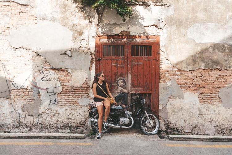 georgetown_streetart_pipa_boy_motorcycle